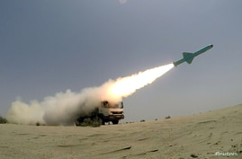FILE PHOTO: An Iranian locally made cruise missile is fired during war games in the northern Indian Ocean and near the entrance…