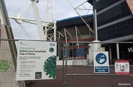 Coronavirus signs are seen in the city centre as the coronavirus disease (COVID-19) outbreak continues in Cardiff, Wales,…