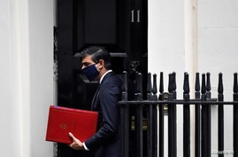 Britain's Chancellor of the Exchequer Rishi Sunak leaves Downing Street in London, Oct. 20, 2020.