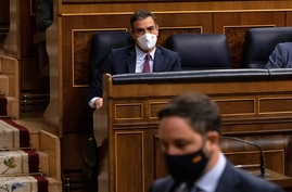 Santiago Abascal, leader of Spain's far-right party Vox, walks to give his speech as Prime Minister Pedro Sanchez looks on…