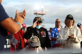 A World War II veteran salutes during U.S. President Donald Trump's campaign rally at The Villages Polo Club.