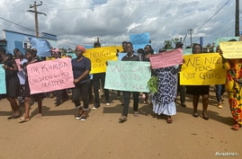 Schoolchildren, their parents and teachers hold a protest after gunmen opened fire at a school, killing at least six children…