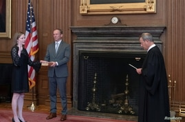 U.S. Supreme Court Chief Justice John Roberts administers the judicial oath of office to Judge Amy Coney Barrett.