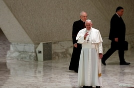 Pope Francis greets people as he arrives at Aula Paolo VI for the weekly general audience at the Vatican, October 28, 2020…