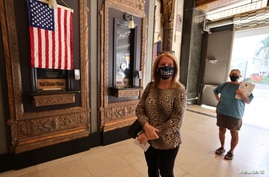 Laura Cohen, 62, waits in line to vote at the Pantages Theater, during the global outbreak of the coronavirus disease (COVID-19…