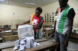 Election officials start to count the ballots during the presidential election in Abidjan, Ivory Coast October 31, 2020…
