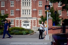 FLE- In this Sept. 18, 2015 file photo, a University of Connecticut student waits for the traffic light to change outside of a…