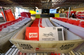 Ballots mailed-in are ready to be sorted at the King County Elections office, Oct. 20, 2020, in Renton, Wash.