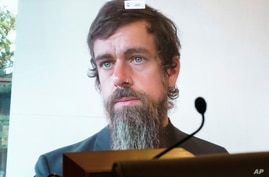 Twitter CEO Jack Dorsey appears on a screen as he speaks remotely during a hearing before the Senate Commerce Committe