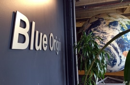 The lobby of space venture Blue Origin features a replica of the Earth, Tuesday, March 8, 2016, in Kent, Wash. The private…