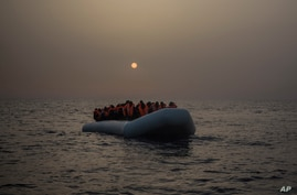 2017 AP YEAR END PHOTOS - African refugees and migrants, mostly from Sudan and Senegal, wait for assistance aboard a rubber…
