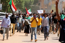Sudanese protesters march to the Cabinet's headquarters in the capital, Khartoum, Sudan, Monday, Aug. 17, 2020. The protesters…