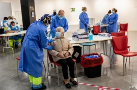 Madrid Emergency Service health workers conduct rapid antigen tests for COVID-19 in the southern neighborhood of Vallecas in Madrid, Spain, Oct. 2, 2020.
