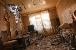Damages are seen inside an apartment in a residential area after shelling during a military conflict in self-proclaimed…