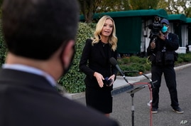 White House press secretary Kayleigh McEnany, talks to the media, Sunday, Oct. 4, 2020, outside the White House in Washington.