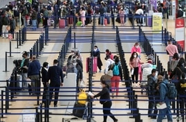 Passengers check-in at the Jorge Chavez International Airport in Callao, Peru, Monday, Oct. 5, 2020. After international…