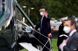President Donald Trump boards Marine One to return to the White House after receiving treatments for covid-19 at Walter Reed…