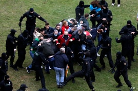 People clash with policemen during an opposition rally to protest the official presidential election results in Minsk, Belarus, Oct. 11, 2020.