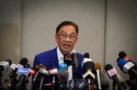 Malaysian opposition leader Anwar Ibrahim speaks during a press conference after meeting the nation's king in Kuala Lumpur, Malaysia, Oct. 13, 2020.