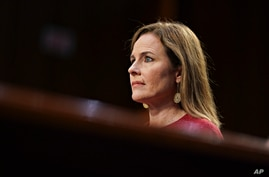 Supreme Court nominee Amy Coney Barrett listens during a confirmation hearing before the Senate Judiciary Committee, Tuesday,…
