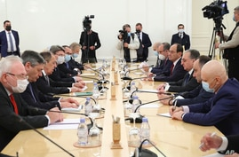 FILE - In this Oct. 12, 2020, file photo released by Russian Foreign Ministry Press Service, Russian Foreign Minister Sergey Lavrov, third from left, meets with Armenia's Foreign Minister Zohrab Mnatsakanyan in Moscow, Russia.