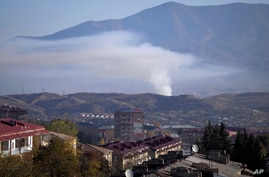 Smoke rises after shelling by Azerbaijan's artillery during a military conflict in Stepanakert, the separatist region of Nagorno-Karabakh, Oct. 24, 2020.