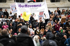 Protestors gather in Trafalgar Square, during a coronavirus anti-lockdown protest, in London, Oct. 24, 2020.