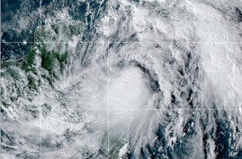 This satellite image provided by the National Oceanic and Atmospheric Administration shows Tropical Storm Zeta, Oct. 25, 2020, at 2110 GMT (5:10 p.m. ET).