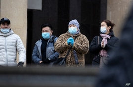 People wearing face masks to help curb the spread of the coronavirus leave a subway in Moscow, Russia, Oct. 26, 2020. Russia's caseload remains the fourth largest in the world.
