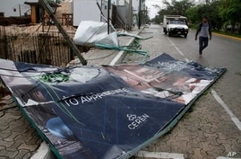 A billboard lays on the ground, toppled by Hurricane Zeta in Playa del Carmen, Mexico, Oct. 27, 2020.