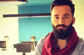 """Shkumbin Kajtazi says he can't pinpoint an article that may have led to the attack on his car this week in Kosovo, but as the owner of a local news site, """"I think responsibility about any article we publish falls on me."""" (Facebook)"""