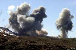 FILE - This undated photo released by the Army Times March 5, 2002, shows smoke rising from Taliban and al-Qaida positions in the hills of Sirkankel, Afghanistan, after heavy U.S. bombing.
