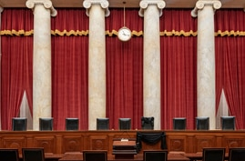 FILE - This Sept. 19, 2020, photo provided by the Supreme Court, shows the Bench draped in memory of liberal Justice Ruth Bader Ginsburg, at the Supreme Court in Washington. Republicans are rushing to fill the vacant seat with their conservative nominee.