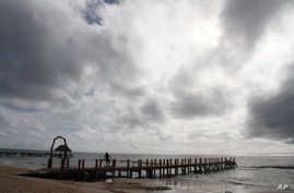 A worker secures a dock before Hurricane Delta is due to arrive near Playa del Carmen, Mexico, Oct. 6, 2020.