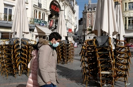 Stacked chairs in front of a cafe in Lille, northern France, Oct. 12, 2020.
