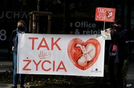 "Anti-abortion activists hold a protest in front of Poland's Constitutional Court, in Warsaw, Poland, Oct. 22, 2020. The signs read ""Yes to Life"" in Polish."