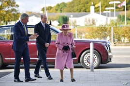 Britain's Queen Elizabeth II and Prince William speak with Chief Executive Gary Aitkenhead during a visit to the Defense Science and Technology Laboratory (DSTL) at Porton Down, Britain, Oct. 15, 2020.