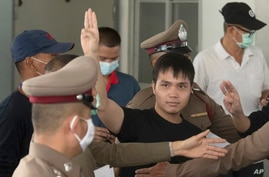 FILE - Thai protest leader Tattep Ruangprapaikitseree flashes a three-finger salute, a symbol of resistance, as he leaves the Samranrat police station for a court appearance in Bangkok, Thailand, Aug, 26, 2020.
