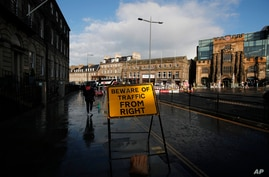 """FILE - A road signs reads """"Beware of Traffic from Right,"""" in Edinburgh, Scotland. Disgruntlement over Brexit and the coronavirus pandemic are breathing new life into the push for Scottish independence."""