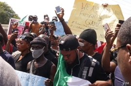 Nigerians in Accra, Ghana, listen to an address at an End SARS demonstration, Oct. 21, 2020.