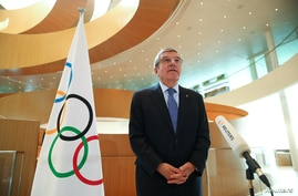 FILE - Thomas Bach, President of the International Olympic Committee (IOC), speaks in Lausanne, Switzerland, March 25, 2020.