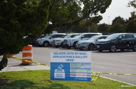 FILE - A sign is seen outside a ballot drop-off site in Houston, Texas, Oct. 1, 2020.