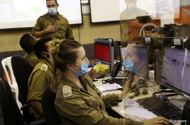 Military personnel at the Israeli Defence Force Corona Task Force Headquarters conduct epidemiological investigations as part of the army's effort to trace chains of infection to curb the spread of the COVID-19 in Ramle, Sept. 17, 2020.