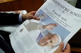 """The front page of the Vatican newspaper, L'Osservatore Romano shows Pope Francis with his latest encyclical titled """"Fratelli Tutti"""" (Brothers All) at the Vatican, Oct. 4, 2020."""