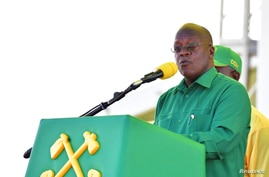 Tanzania's President John Magufuli addresses his supporters during his presidential campaign rally at the Tanganyika Parkers Grounds in Kawe in Dar es Salaam, Oct. 14, 2020.