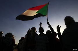 Sudanese women march in Khartoum to mark International Day for Eliminating Violence against Women, in the first such rally held…