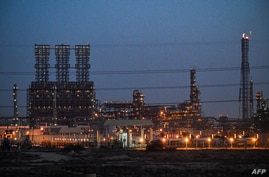 This picture taken on December 11, 2019, shows a view of a refinery at the Jubail Industrial City, about 95 kilometres north of…
