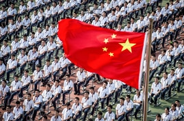 Students attend the 100th anniversary of the founding of Wuhan High School on the first day of the new semester in Wuhan in…