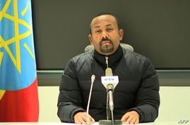 This frame grab from a video obtained from the Ethiopian Public Broadcaster (EBC) on November 4, 2020, shows Ethiopian Prime…