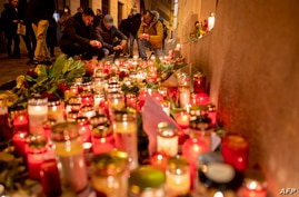 People light up candles outside Vienna's main synagogue near the site of the terrorist attack in Vienna, Austria on November 4,…